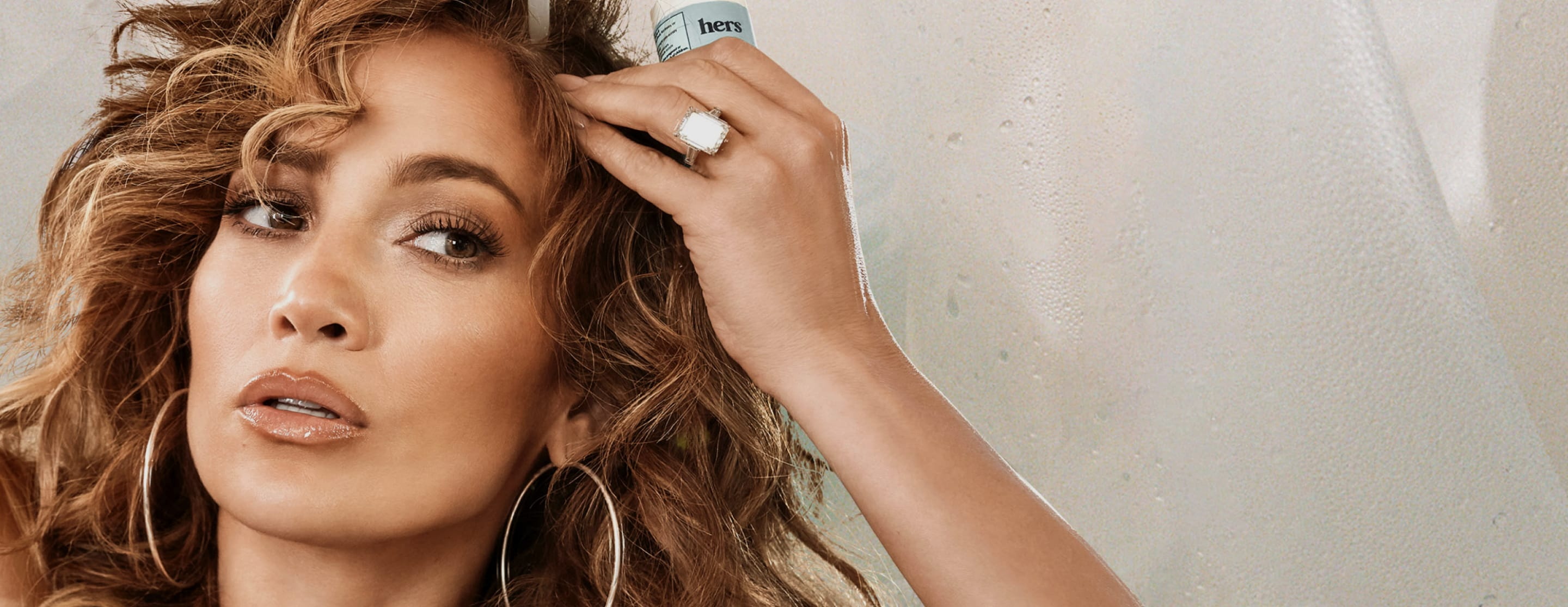 Jlo holding hair product